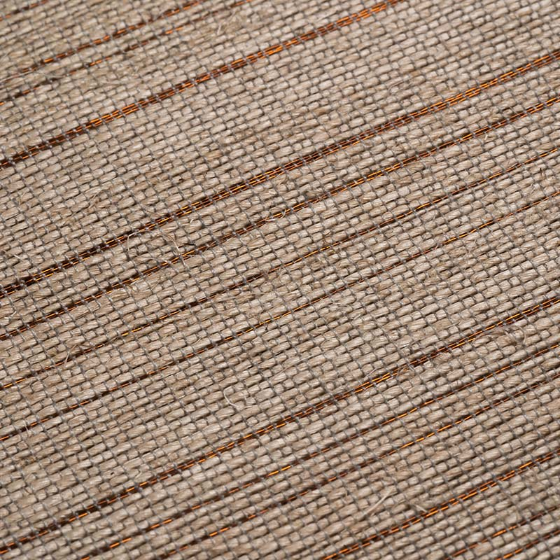 Closeup to Sierra weave textile handwoven in plantain fiber and copper threads.