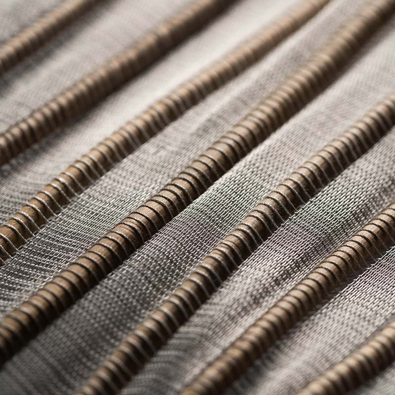 Closeup to Sui weave textile handwoven in yaré fiber and stainless steel threads.