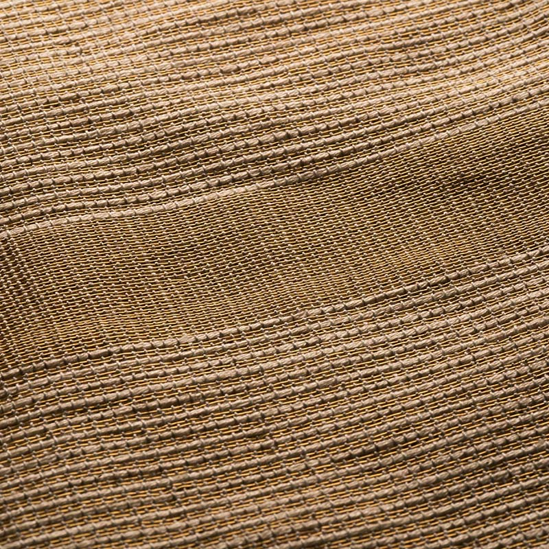 Closeup to Par weave textile handwoven in plantain fiber and gold silver plated metal threads.